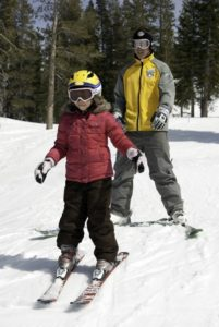 Tips for teaching your child how to ski or snowboard