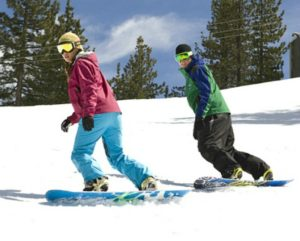 With nice spring-like weather, this is a good time of year to take a snowboarding lesson at a Lake Tahoe ski resort.