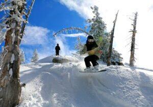 A snowboarder enjoys a powder day at Diamond Peak ski resort.