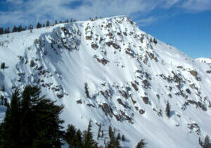After embarking his snowmobile, the man took several steps toward the edge, unknowingly stepping onto a shelf of ice hanging over Frog Lake Cliffs near Tahoe Donner.