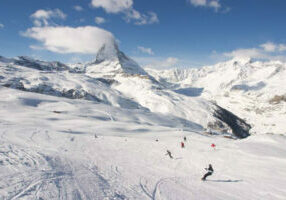 The iconic Matterhorn towers over more than 3,500 acres (1,416 hectares) of terrain that spans both Switzerland and Italy, offering Swiss hospitality coupled with Italian lifestyle, in the highest skiable terrain offered in the picturesque Alps.
