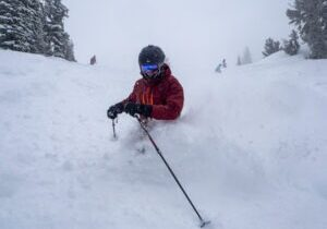 A Mt. Rose skier is waist deep in powder Sunday after the resort received a foot of new snow.