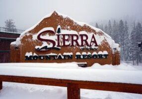 Sierra-Tahoe sign buried in snow